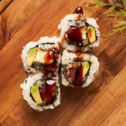 4 Sushi Rolls on Wood Plank